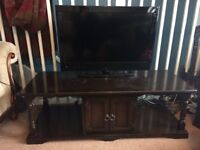 Dark wood coffee table/ tv stand with storage
