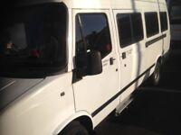 White 17 seater ldv minibus