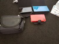 3 nintendo ds consoles with games