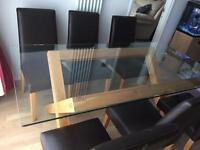 Glass dining room table on a wooden frame
