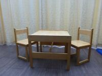 Wooden table and two chairs for toddlers