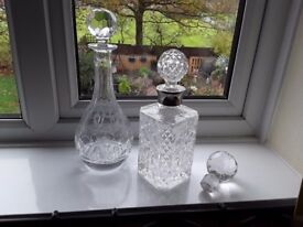 Two glass decanters.