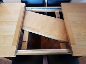 Furniture Mountain Oak Dining Table - almost new and barely used. Seats 4-8 with extendor