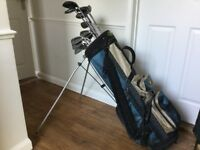 Set of Wilson cubs,Driver and various woods,in carrying bag.