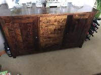 Dark wood sideboard, dining table, 6 cream chairs and storage unit