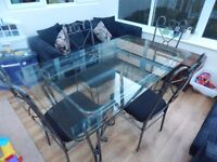 Metal Table with Glass Top and 6 recovered chairs in black - very stylish