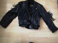 Child's black leather fringed biker jacket.