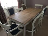 Distressed dining table and eight cushioned chairs / ex-showhouse.