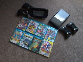 NINTENDO WII U with accessories and games.