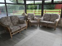 Suite of cane sunroom / conservatory furniture. Sofas and table.