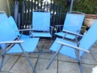 four blue garden folding chairs