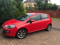 Fiat Punto Evo Red (11) 1.4 Hatchback for sale. Very low mileage and kept in excellent condition!