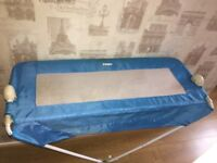 Blue Tomy toddler bed guard rail