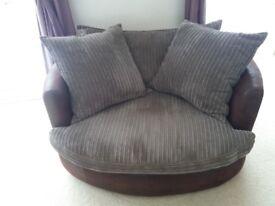 Brown swivel cuddle chair