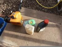 mc culloch tm 210 strimmer with 2 stroke oil mixing bottle and line