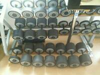 Technogym commercial dumbbell set with 2 racks.