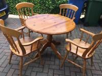 Solid pine dining table and 4x Carver chairs