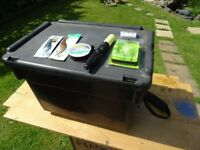 large fishing box with carry strap with pike hooks line , spoons and float