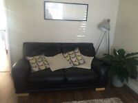 DFS Black leather sofa and two armchairs