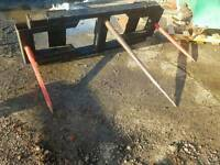 Tractor front loader bale spike with massey ferguson brackets
