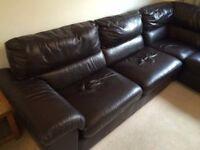 Large Black leather corner sofa bed.