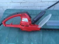 Electric hedge trimer