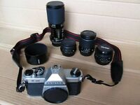 PENTAX K1000 SLR PLUS 28MM, 50MM, 135MM & 80-210MM LENSES, FILTERS AND ACCESSORIES