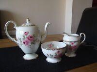 two sets matching tea pots, milk jug and sugar bowls