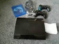 Playstation 3 super slim 60GB, 2 x controllers (1 custom controller) 1 x game