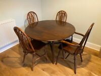 Ercol drop leaf dining table and six chairs