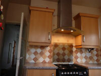 A selection of kitchen units, Sink including taps, hotpoint cooker with oven and extractor fan.