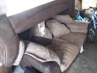 2 two seater sofas.brown and cream .covers all come off to wash..