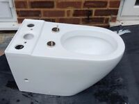 New Toilet pan, close coupled cistern, soft close toilet seat complete