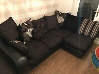 Immaculate left arm facing part natural black leather corner sofa with chunky foot stool