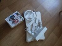 Wii Console, fit board, 3 controllers, 3 nunchucks, 10 games icl. Mario, wii fit, fifa