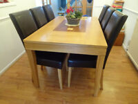 Oak Dining Table (1500mmx900mm) with patterned inlay + 6 Black Leather Chairs. VGC.