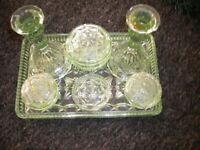 A GREEN GLASS 10 PIECE DRESSING TABLE SET