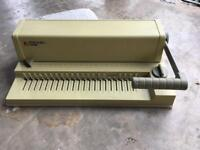 Paper comb punch binding machine.