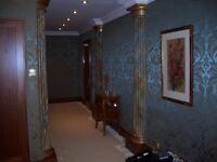 Professional group of multiskilled builders ( painter , decorator , tiler , carpenter )