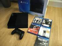 Playstation 4 with Controller and 5 Games