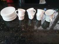 8 piece Alessi coffee cups and saucers. Esspresso size.
