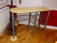 compact kitchen table with built under wine and vegetable rack