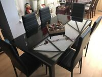 Wow factor smoked glass dining table & 6 chairs - very stylish !!