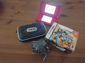 NINTENDO DS IN RED WITH GAMES AND CHARGER HARDLY USED