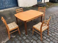 Extendable teak dining table with 4 teak chairs