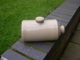 A vintage stoneware hot water bottle made by Pearson of Chesterfield.
