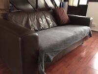 Brown faux leather 3 seater sofa used condition