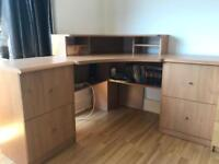 Wooden corner desk with two matching pedalstool units