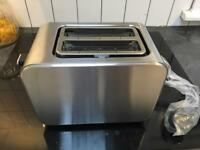 Stainless steel toaster. Brand new in box.