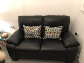 2 Stunning black leather 2 seater sofas